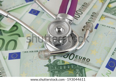 Stethoscope on euro banknotes, cost of healthcare concept