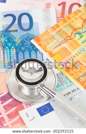 Stethoscope on Europe banknote concept financial health check