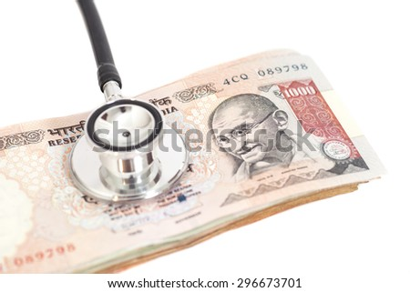 Stethoscope on indian 1000 rupee notes