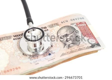 Stethoscope on indian 1000 rupee notes - stock photo