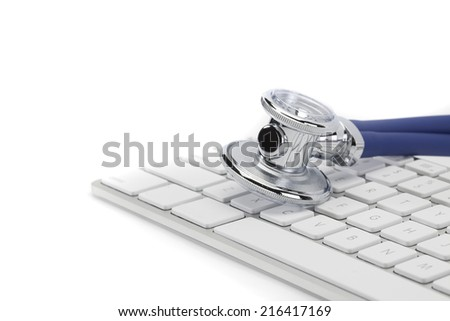 Stethoscope on keyboard  - stock photo