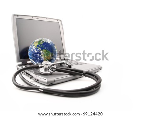 Stethoscope on laptop keyboard with earth on white background