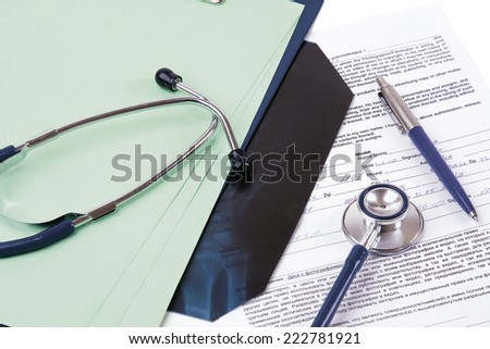 Stethoscope on medical billing statement on table, all text is anonymous. - stock photo