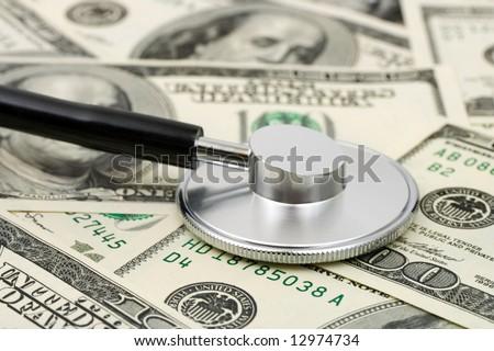 Stethoscope on money background, medical concept - stock photo