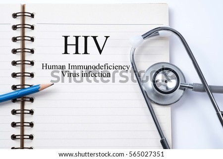 Stethoscope on notebook and pencil with HIV (Human Immunodeficiency Virus)  words as medical concept