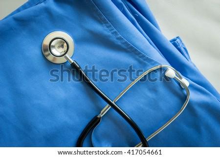 Stethoscope on nurse & doctor coat background - stock photo