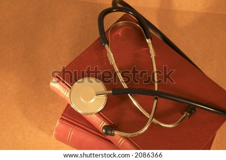 stethoscope on old rusty books, with colorful light