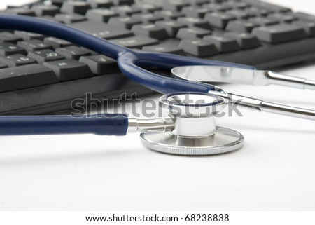 Stethoscope on silver laptop