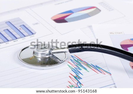 Stethoscope on stock chart - market analysis - stock photo