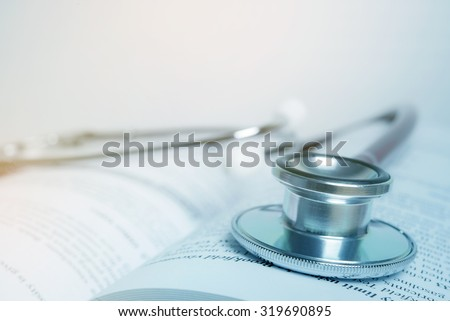 Stethoscope on text book  - stock photo