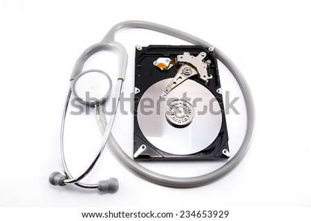 stethoscope on the hard disk drive over white - stock photo