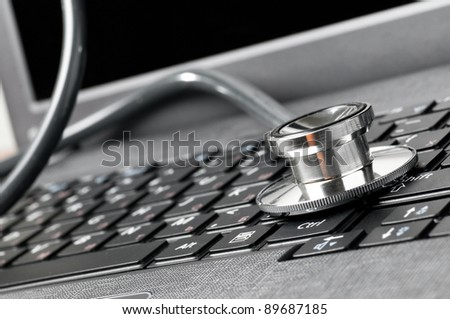 stethoscope on the laptop keyboard, close-up view - stock photo