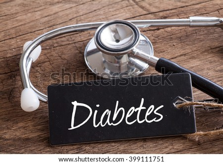 Stethoscope on wood with Diabetes words as medical concept - stock photo