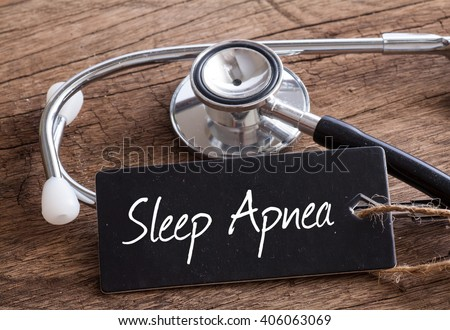 Stethoscope on wood with Sleep Apnea words as medical concept - stock photo