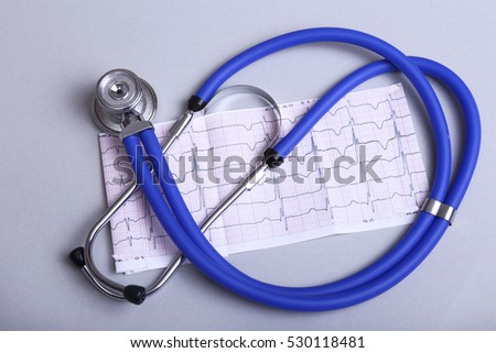 stethoscope, red heart and cardiogram isolated on white
