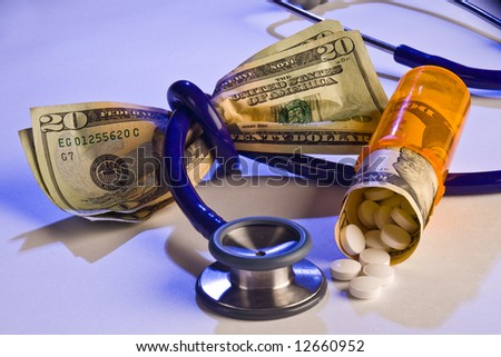 Stethoscope tied around money and pills spilling out of prescription bottle