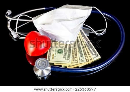 Stethoscope with a surgical mask and money - stock photo