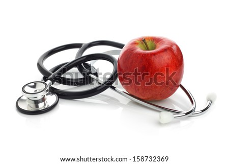 Stethoscope with apple concept for diet, healthcare, nutrition or medical insurance - stock photo