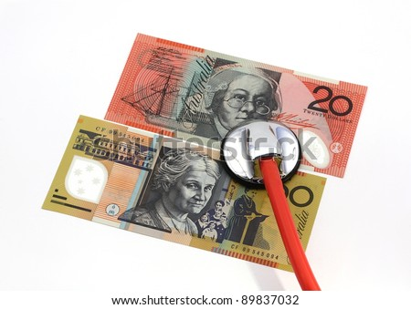 Stethoscope with Australian banknotes, isolated over white - stock photo