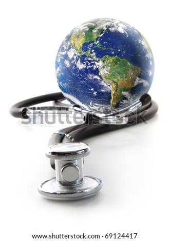 Stethoscope with globe on a white background - stock photo
