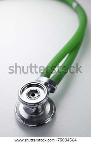 Stethoscope with green tube in close-up view. - stock photo