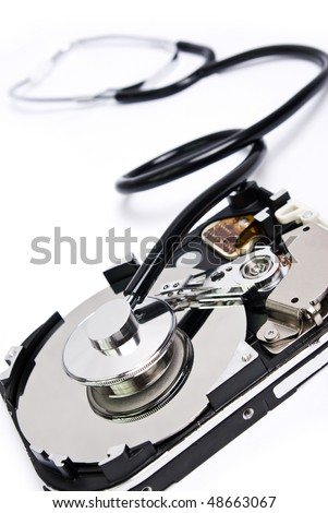 stethoscope with hard disc - stock photo
