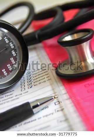 stethoscope with health chart - stock photo