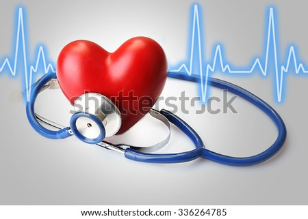Stethoscope with heart and cardiogram - stock photo