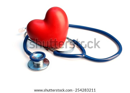 Stethoscope with heart on light background - stock photo