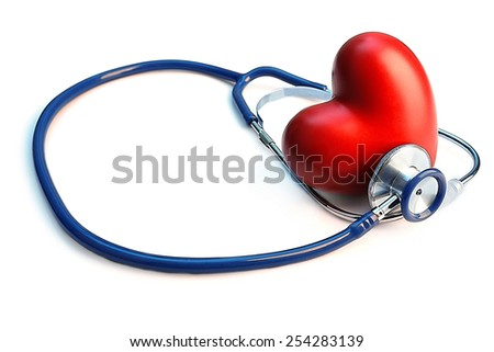 Stethoscope with heart on light blue background - stock photo