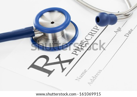 Stethoscope with medical prescription - stock photo
