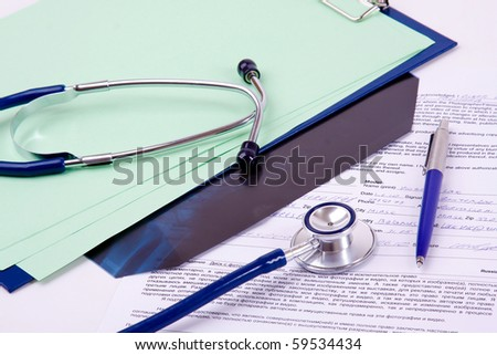 stethoscope with notebook