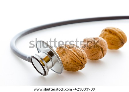 Stethoscope with nuts - stock photo