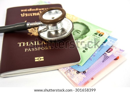 stethoscope with passport and banknote  on white background. - stock photo
