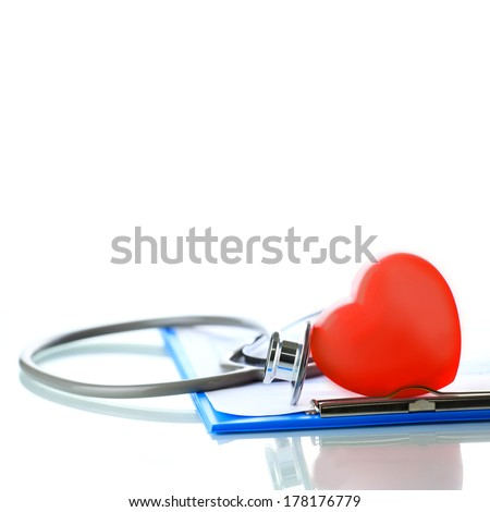 Stethoscope with red heart - stock photo