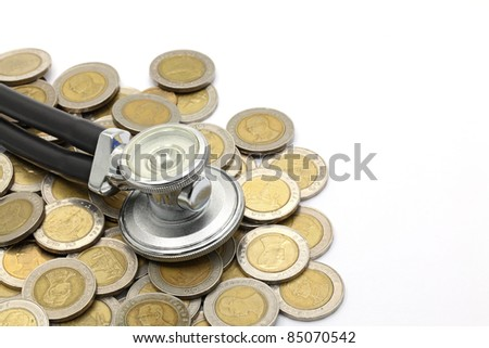 stethoscopeon currency coin for financial examination healthy concept