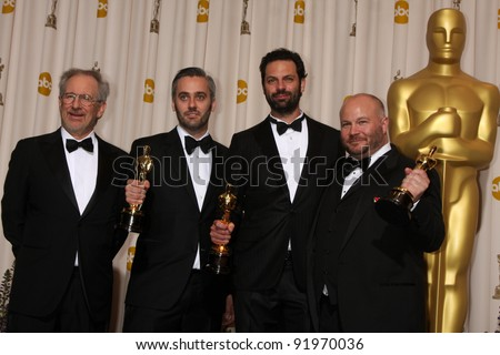 Steven Spielberg, Emile Sherman, Iain Canning and Gareth Unwin at the 83rd Annual Academy Awards Press Room, Kodak Theater, Hollywood, CA. 02-27-11