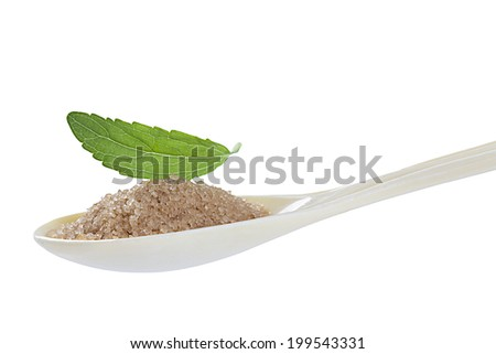 Stevia leaf with spoon of brown sugar - stock photo