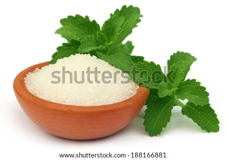 Stevia with sugar on a brown bowl over white background - stock photo