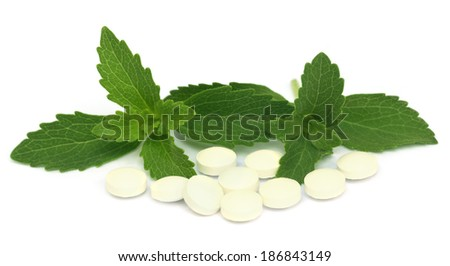 Stevia with tablets over white background - stock photo