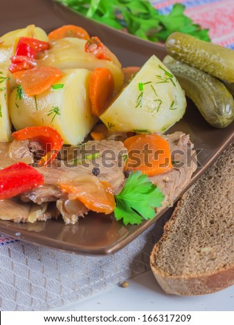 stew meat with carrots, peppers, onions and tomatoes