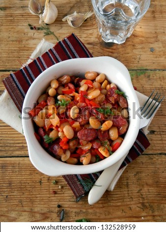Stew of beans , vegetables and smoked sausages - stock photo