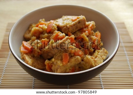 Stew tempeh with carrots, leeks and soy sauce in a bowl - stock photo