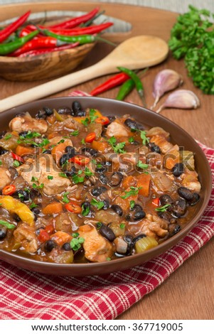 stew with black beans, chili, chicken and vegetables, vertical