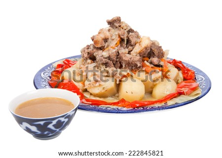 Stew with potatoes sweet pepper on a plate isolated on white background - stock photo