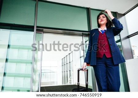 Stewardess in uniform out of the building after flight
