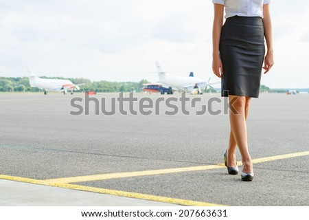 Stewardess on the airfield. Place for your text. - stock photo