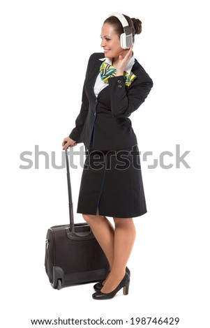 stewardess with a luggage bag listening to music