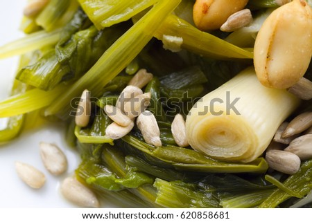 Stewed beet leaves and green garlic with seeds