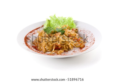 stewed cabbage on white plate - stock photo